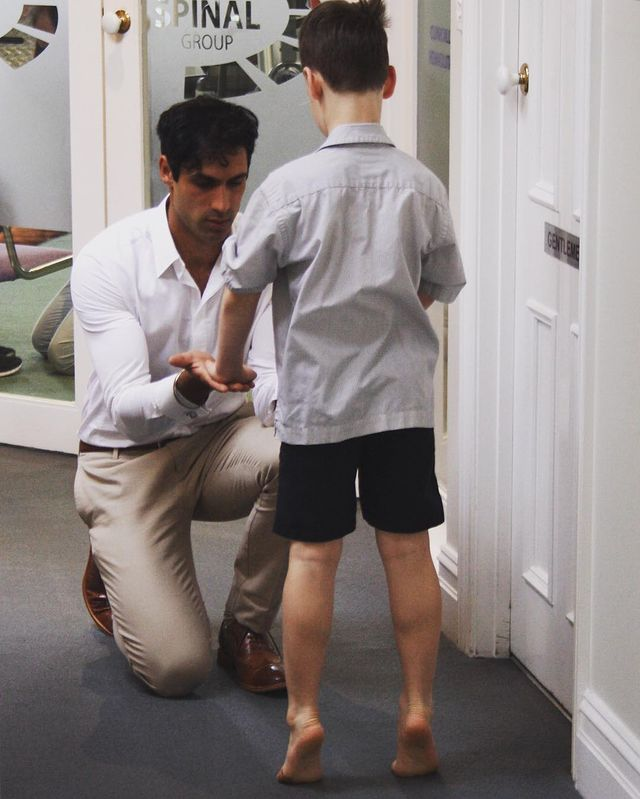 Steve Singh treating a young patient