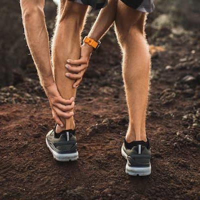 male-runner-holding-injured-calf-muscle-and-suffer-JWUGYE3 (2)