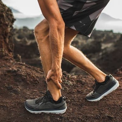 male-runner-holding-injured-calf-muscle-and-suffer-SUL6F6J (1)
